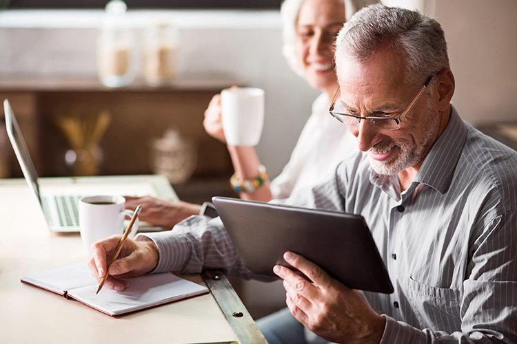Elderly couple calculating costs of long-term care insurance
