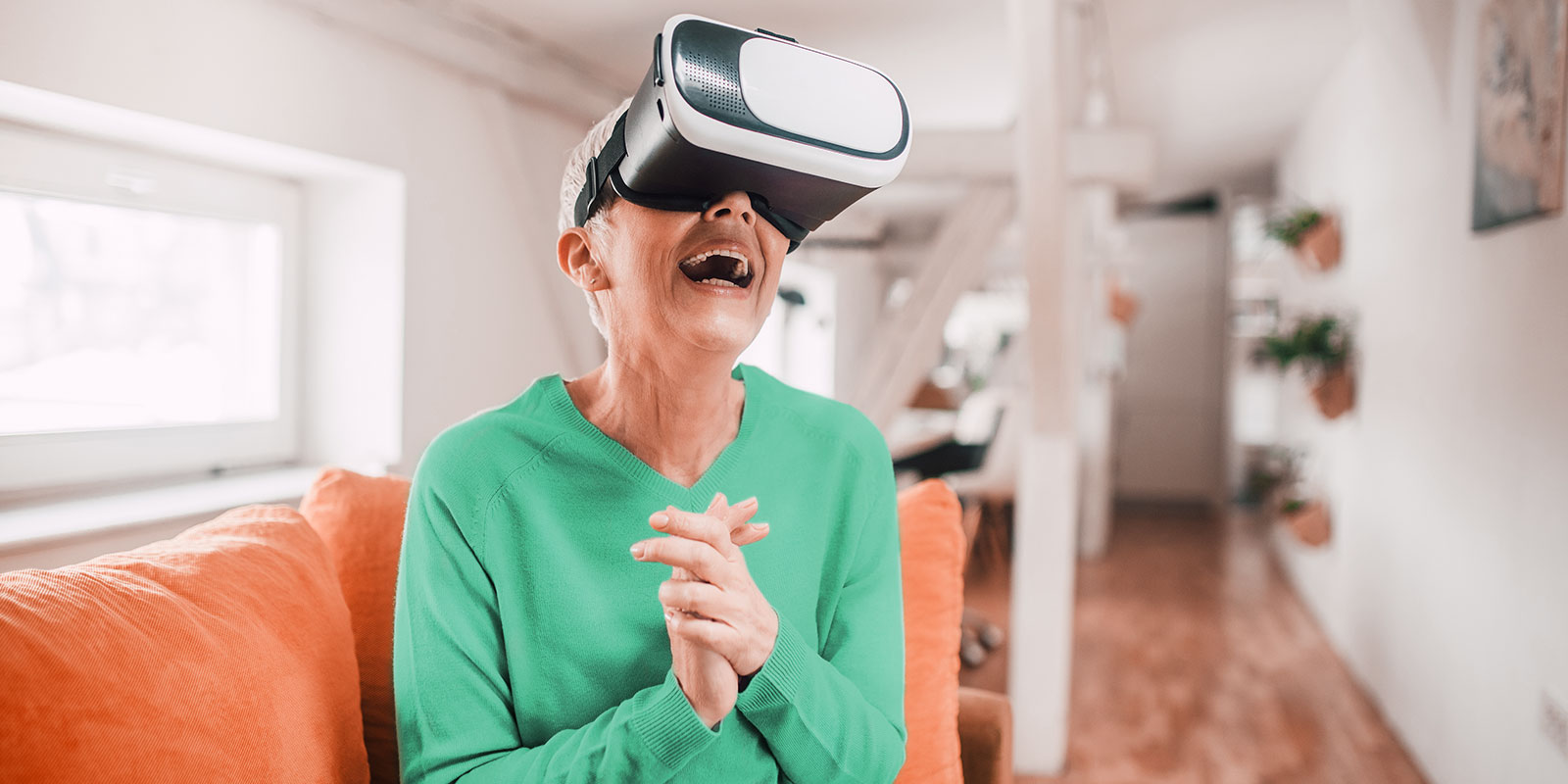 elderly woman wearing virtual reality headset and smiling